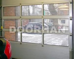 Подъемные промышленные автоматические секционные ворота Doorhan